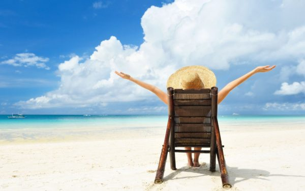 Woman enjoying sunshine on the beach